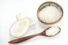 Kokosnöt med skeden Arkivfoto