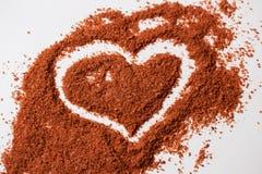 Kokosnöten kaffe, choklad skurar i styrkan av hjärtan royaltyfria foton