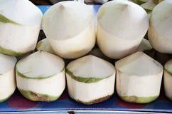 Kokosnötter med fruktsaft inom. Royaltyfri Foto