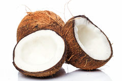 Kokosnötter på vitbakgrund Royaltyfri Bild