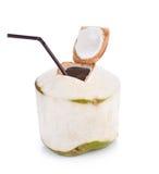 Kokosnötvattendrink på vit bakgrund med den snabba banan Royaltyfria Foton