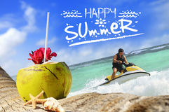 Kokosnüsse und jetski auf dem Strand Lizenzfreies Stockfoto