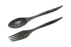 kokosnotenshell vork en lepel op wit wordt geïsoleerd dat Stock Foto's