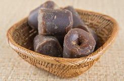 Kokosnöten gömma i handflatan underminerar socker III Royaltyfria Bilder