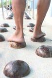 Kokosnussshell für Fußmassage. Lizenzfreies Stockfoto
