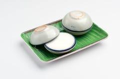 Kokosowego mleka custard w małej porcelany filiżance Obrazy Royalty Free