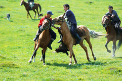 Kokpar - traditional nomad horses competitions. BISHKEK, KYRGYZSTAN - MAY 14: Kokpar - traditional nomad horses competitions (fight for a body of goat) in Stock Image