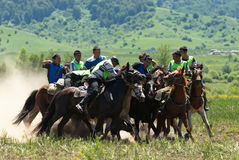 Kokpar - traditional nomad horses competitions. BISHKEK, KYRGYZSTAN - MAY 14: Kokpar - traditional nomad horses competitions (fight for a body of goat) in Royalty Free Stock Photos