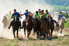 Kokpar - traditional nomad horses competitions. LEPSINSK, KAZAKHSTAN - June 14: Kokpar - traditional nomad horses competitions (fight for a body of goat) in Royalty Free Stock Photography