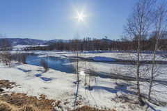 Koksa River flowing near the mountains in early spring Royalty Free Stock Photos