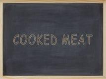 Koksujący mięso pisać w kolorze żółtym na blackboard obrazy royalty free