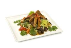 Kokt kött för Shiitakechampinjoner med grönsaker Arkivfoto