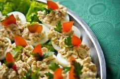 Kokta ägg med fiskkrämtoppning Arkivbild