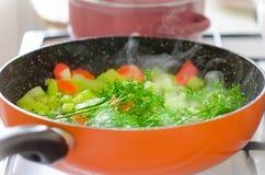 Kokta sommargrönsaker Arkivfoto