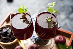 Kokum Sharbat, Juice or Sherbet OR summer coolant drink made up of Garcinia indica. With raw fruit, served in a glass with mint leaf. selective focus stock images