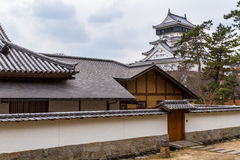 Kokura Castle in Kitakyushu, Japan. Main keep of Kokura Castle viewed from behind the Japanese garden complex. This modern reconstruction is based on the castle Royalty Free Stock Photography