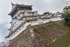 Kokura Castle in Kitakyushu, Japan. Main keep with wall and moat of Kokura Castle in Kitakyushu, Japan. This modern reconstruction is based on the castle built Stock Image