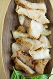 Kol-kokaad grillad griskötthals (eller Ko Mu Yang i thailändskt språk) royaltyfria foton