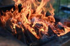 Kol- och brandflamma Arkivfoton