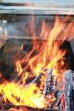 Kol- och brandflamma Arkivfoto