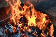 Kol- och brandflamma Arkivbild
