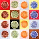 Kolaż od różnych barwionych round ceramicznych talerzy z spirala wzorem Zdjęcia Royalty Free