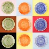 Kolaż od różnych barwionych round ceramicznych talerzy z spirala wzorem fotografia stock
