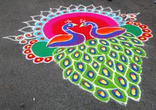 Beautiful colouring Kolam Decorating. Kolam, which means beauty in Tamal, are attractive ornametal or ceremonial designs drawn on the floor in front of homes Stock Photos