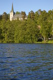 Kolbotn Church in Norway. Kolbotn church in the trees along a river in Oppegård in Norway Stock Photo
