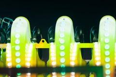 Kolejek górskich świateł szczegół w parku rozrywki przy nocą Zdjęcia Stock