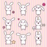 Kolekcja śmieszni i śliczni szczęśliwi kawaii króliki royalty ilustracja