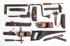 Kolekcja antykwarscy woodworking narzędzia na białym płótnie zdjęcia royalty free