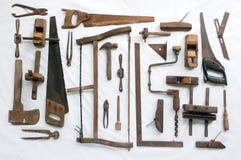 Kolekcja antykwarscy woodworking narzędzia na białym płótnie Fotografia Stock
