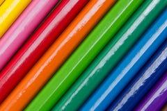 Kolekcja barwioni ołówki tworzy tło Zdjęcia Royalty Free