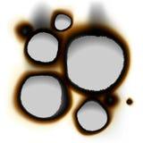 Kolekcja burnt dziury w białym papierze Fotografia Stock