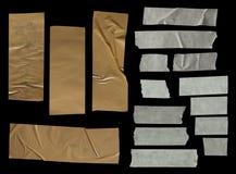Kolekcja różnorodni adhezyjnej taśmy kawałki na czarnym tle obraz royalty free