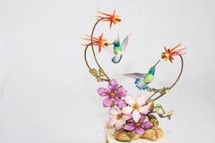 Kolibries op vertoningstribune stock foto's