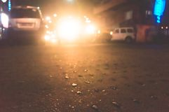 Kolkata City at foggy rainy night with motion blur effect. Car flares light effect realistic white glowing round headlight light royalty free stock photography