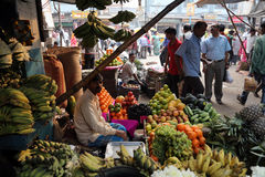 Kolkata fruit market. Street trader sell fruits outdoor on February 11, 2014 in Kolkata India. Only 0.81% of the Kolkata`s workforce employed in the primary Stock Photos