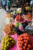Kolkata fruit market. Street trader sell fruits outdoor on February 11, 2014 in Kolkata India. Only 0.81% of the Kolkata`s workforce employed in the primary Royalty Free Stock Photos
