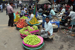Kolkata fruit market. Street trader sell fruits outdoor on February 15, 2014 in Kolkata India. Only 0.81% of the Kolkata`s workforce employed in the primary Royalty Free Stock Photos