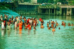Devotees taking holy bath on river Ganges royalty free stock photos