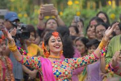 Young girls dancing at Holi / spring festival. Royalty Free Stock Images