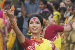 Young girls dancing at Holi / spring festival. Stock Photos