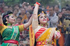 Young girls dancing at Holi / spring festival royalty free stock images