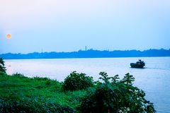Beautiful panorama of Kolkata city on the river Hooghly in a sunny day. Fishing trallers are royalty free stock image