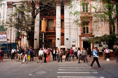 KOLKATA, INDIA: Pedestrians in a crosswalk waiting for the moment to cross the road Royalty Free Stock Photo