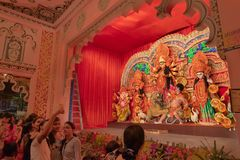 Girls taking selfies of themselves at Durga Puja Pandal, Kolkata, West Bengal, India stock images