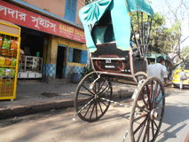 Kolkata Rickshaw. One of the remaining human-powered rickshaws still working in Kolkata, India Stock Images