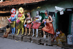 Kolkata's Slum Area. Semi-finished clay idols of the Hindu mythologycal characters 'Dakinis' and 'Yoginis', who will be worshiped along with Hindu Goddess Kali Stock Photography